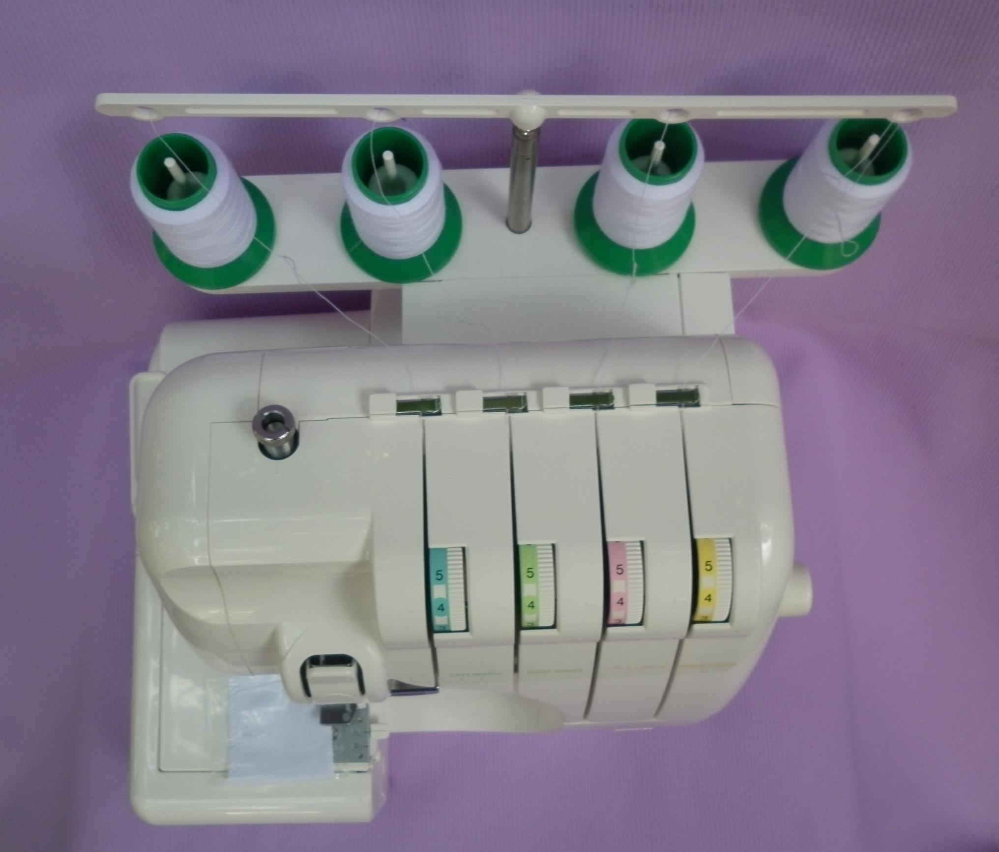 Оверлок ASTRALUX 822 D ( краеобмёточно - стачивающая швейная машина ), блок нитенатяжителей, система против запутывания ниток.